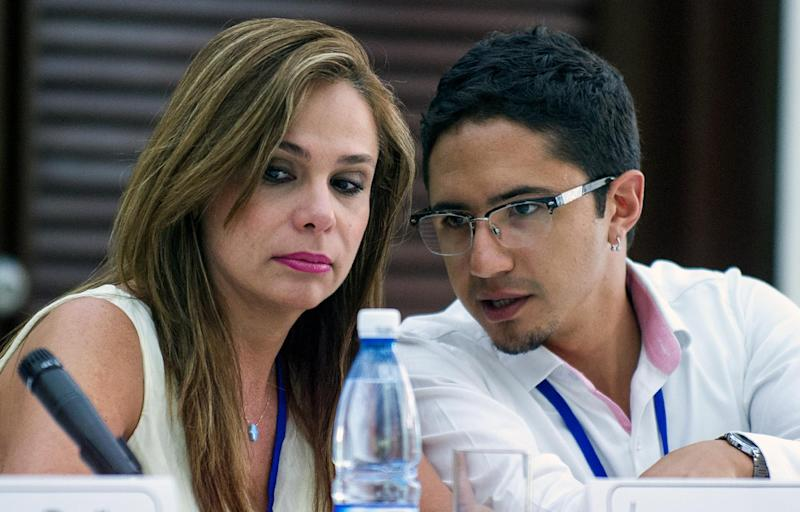 Colombian victims of the armed conflict Angela Maria Giraldo and Jose Antequera hold a press conference on August 16, 2014, in Havana, during peace-talks between FARC-EP members and Colombian government delegation