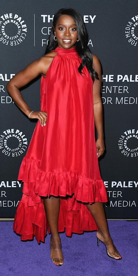 <p>While promoting the final season of <em>How to Get Away with Murder</em>, Aja Naomi King wore a halter dress with a ruffled, asymmetric hemline.</p>