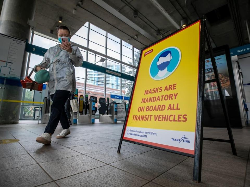 A transit passenger wearing a mask is pictured in Vancouver in August 2020.  (Ben Nelms/CBC - image credit)