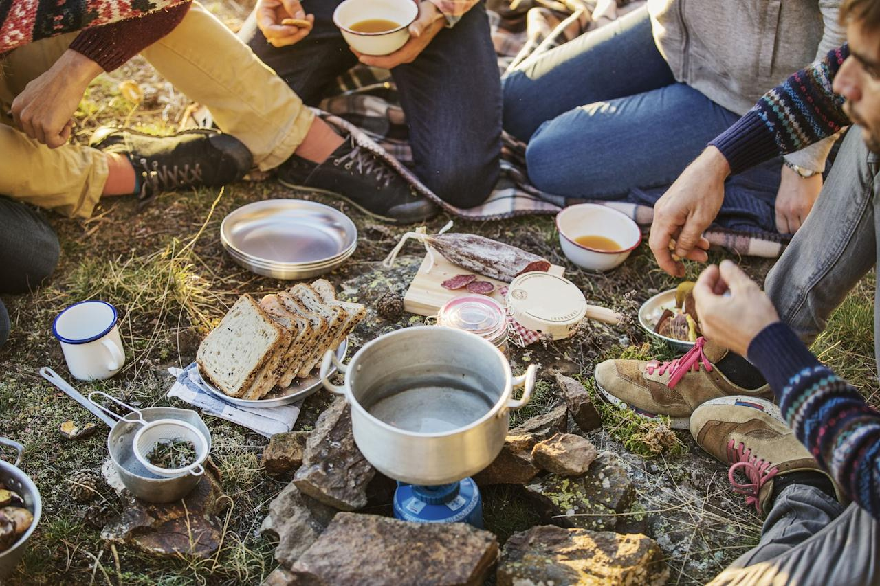 """<p>As much as we'd love to live entirely off <a href=""""https://www.countryliving.com/food-drinks/a28189946/smores-recipe/"""">s'mores</a> and cold beer—pretty much the main things on our <a href=""""https://www.countryliving.com/shopping/g20665764/camping-checklist/"""">camping checklist</a>—all outdoorsy crews <em>should </em>be equipped with the essential camping cookware. Just because you're roughing it in the woods, or simply pulling up at the KOA, doesn't mean you have to skimp on taste if you have  good gear and clever <a href=""""https://www.countryliving.com/food-drinks/g3394/foil-pack-recipes/"""">foil packet dinner recipes.</a> <br></p><p> That's where these portable kitchen essentials come in—everything from camping pan sets, dinnerware, cleanup tools, portable cocktail kits, and obviously, marshmallow roasting sticks—all designed to make eating, and cooking on the go a breeze. With cooking taken care of, you can get down to what's important, relaxing and enjoying the view. Designed to be portable, easy to clean, and highly functional, these tools can easily fit in the trunk and still leave plenty of room for Fido and the tent.  You might be surprised at just how many great options are out there. And whether you prefer to <a href=""""https://www.countryliving.com/food-drinks/g2444/campfire-recipes/"""" target=""""_blank"""">easy campfire recipes</a> or using a <a href=""""https://www.countryliving.com/shopping/g20978079/best-camping-stove/"""">camping stove</a>, there's a space-friendly and affordable grill for all your favorite <a href=""""https://www.countryliving.com/food-drinks/g31/best-grilling-recipes/"""">grilling recipes.</a> Here are all the camping cookware pieces and gear you'll need to make delicious food wherever your adventures take you.</p>"""