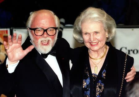 """Richard Attenborough arrives at the Royal premiere of his film """"In Love and War"""" with his wife Sheila Sim in London, in this file picture taken February 12, 1997. REUTERS/Paul Hackett"""