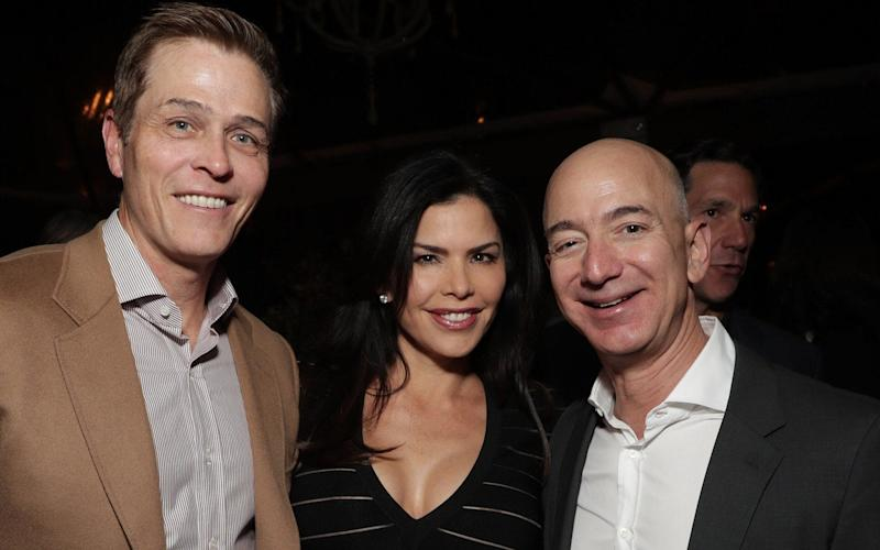 Jeff Bezos, right, with Lauren Sanchez and her husband Patrick Whitesell - Getty Images Contributor