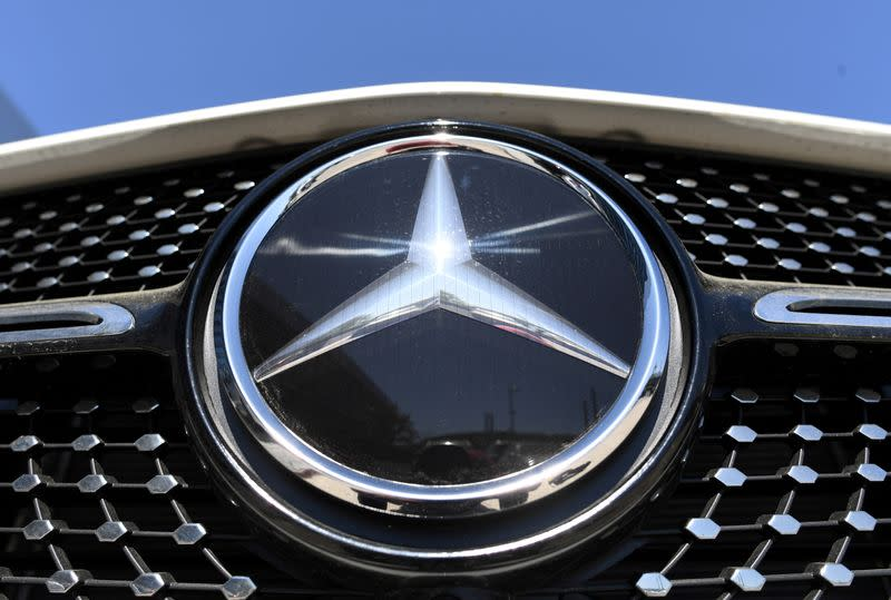 FILE PHOTO: The Mercedes-Benz logo is seen near the Daimler headquarters, as the spread of the coronavirus disease (COVID-19) continues in Stuttgart