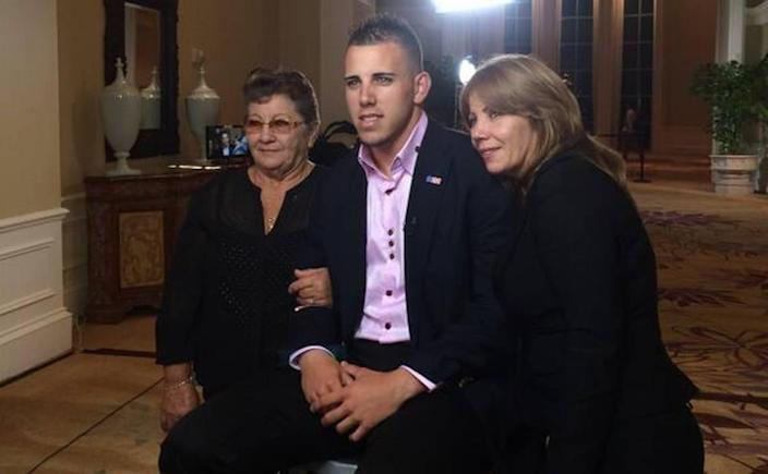 2013 National League Rookie of the Year Jose Fernandez poses with his grandmother, Olga Fernandez Romero, left, and his mother, Maritza Gomez Fernandez.