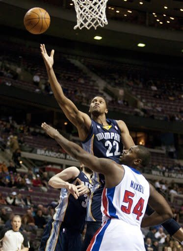 Memphis Grizzlies' Rudy Gay (22) takes a shot over Detroit Pistons' Jason Maxiell (54) in the first half of an NBA basketball game Friday, Jan. 20, 2012, in Auburn Hills, Mich. Gay led all players with 24 points in a 98-81 win over the Pistons.(AP Photo/Duane Burleson)