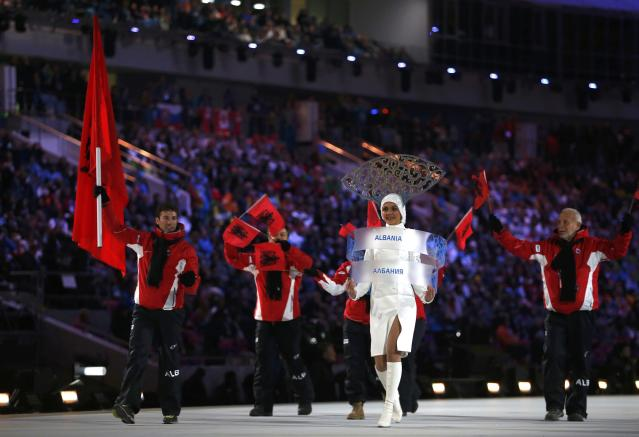 Albania's flag-bearer Erjon Tola leads his delegation as they march in during the opening ceremony of the 2014 Sochi Winter Olympics, February 7, 2014. REUTERS/Jim Young (RUSSIA - Tags: OLYMPICS SPORT)