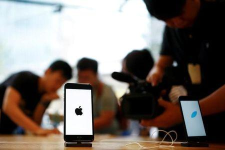 Members of the media film the new iPhone 7 at an Apple store in Beijing