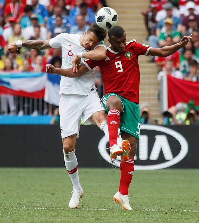 Soccer Football - World Cup - Group B - Portugal vs Morocco - Luzhniki Stadium, Moscow, Russia - June 20, 2018 Portugal's Jose Fonte in action with Morocco's Ayoub El Kaabi REUTERS/Maxim Shemetov