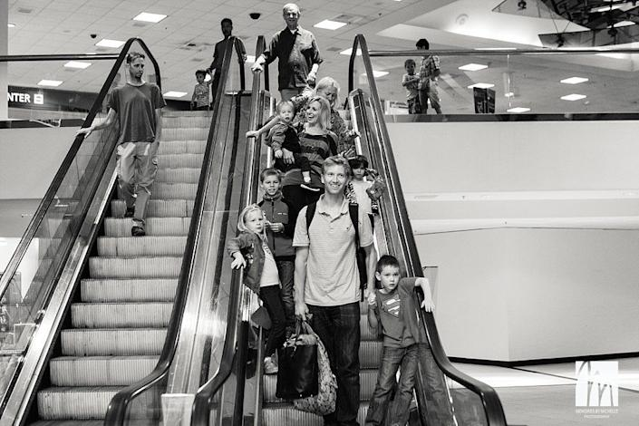 """""""I had never met this family before photographing their arrival at Sacramento airport from Ukraine, but their family had shared their adoption story with me as we waited patiently for their late-night plane to arrive. By the time they emerged, I had tears in my eyes, watching their two adopted children see their new family for the first time, waiting with open arms and USA balloons. As a photographer it's always the greatest privilege to witness some of my clients' most intimate and important moments."""" -- Michelle McDaid"""