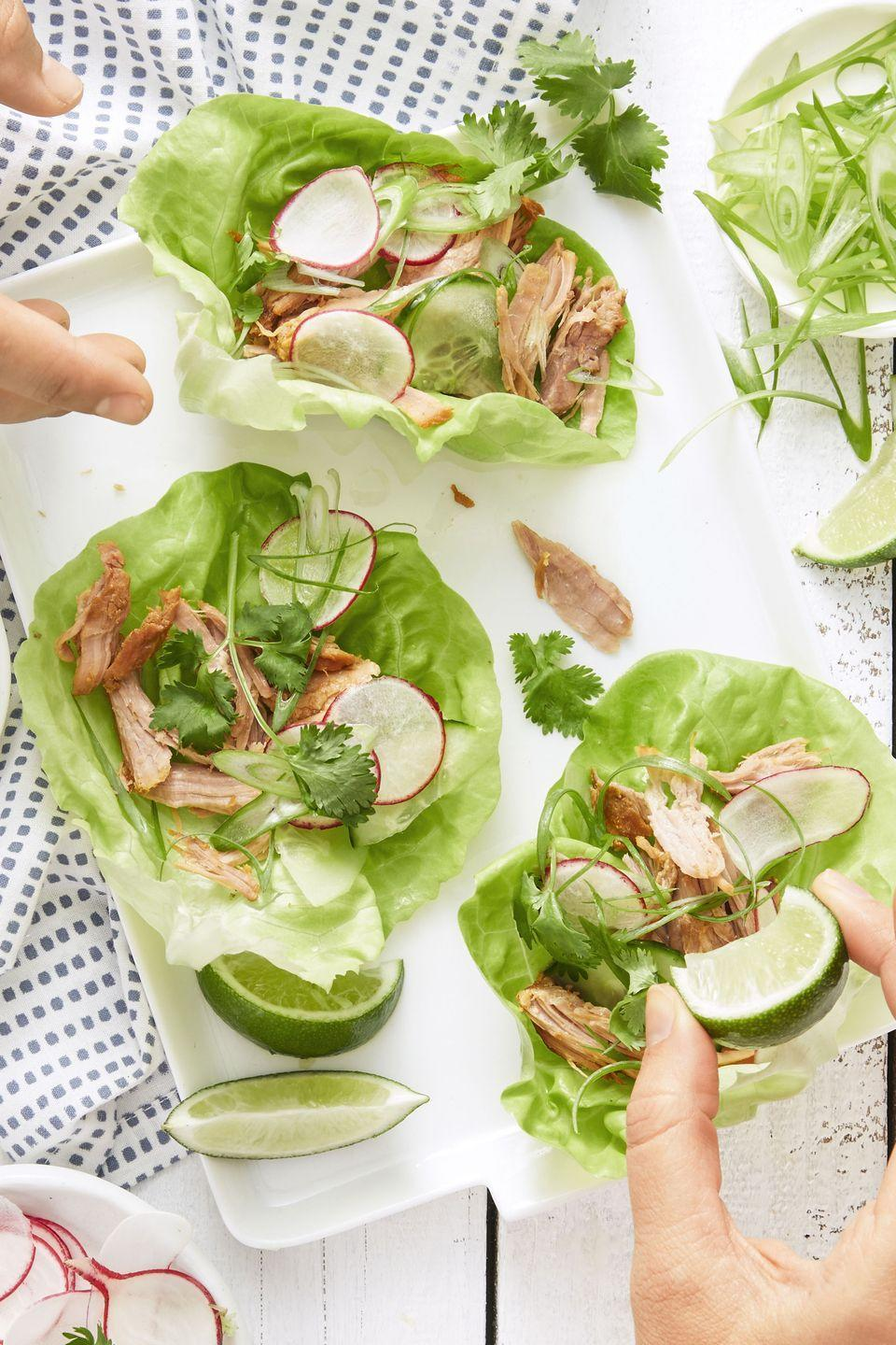 """<p>This <a href=""""https://www.goodhousekeeping.com/food-recipes/healthy/g1364/myplate-inspired-slow-cooker-dinners/"""" rel=""""nofollow noopener"""" target=""""_blank"""" data-ylk=""""slk:summery slow cooker recipe"""" class=""""link rapid-noclick-resp"""">summery slow cooker recipe</a> is a lifesaver. Throw in the pork, head to the beach, and come home to these crazy-delicious Asian-inspired wraps. </p><p><em><a href=""""https://www.goodhousekeeping.com/food-recipes/easy/a34182/korean-pork-lettuce-wraps/"""" rel=""""nofollow noopener"""" target=""""_blank"""" data-ylk=""""slk:Get the recipe for Korean Pork Lettuce Wraps »"""" class=""""link rapid-noclick-resp"""">Get the recipe for Korean Pork Lettuce Wraps »</a></em> </p>"""