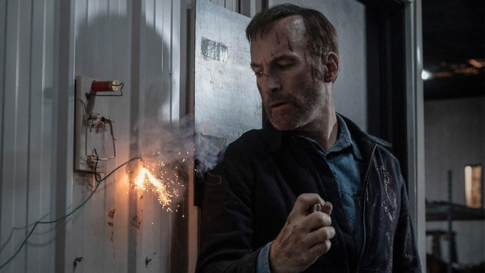 Bob Odenkirk lighting a fuse in Nobody