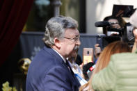 Russia's Governor to the International Atomic Energy Agency (IAEA), Mikhail Ulyanov, addresses the media as he leaves the 'Grand Hotel Wien' where closed-door nuclear talks with Iran take place in Vienna, Austria, Saturday, May 1, 2021. (AP Photo/Lisa Leutner)