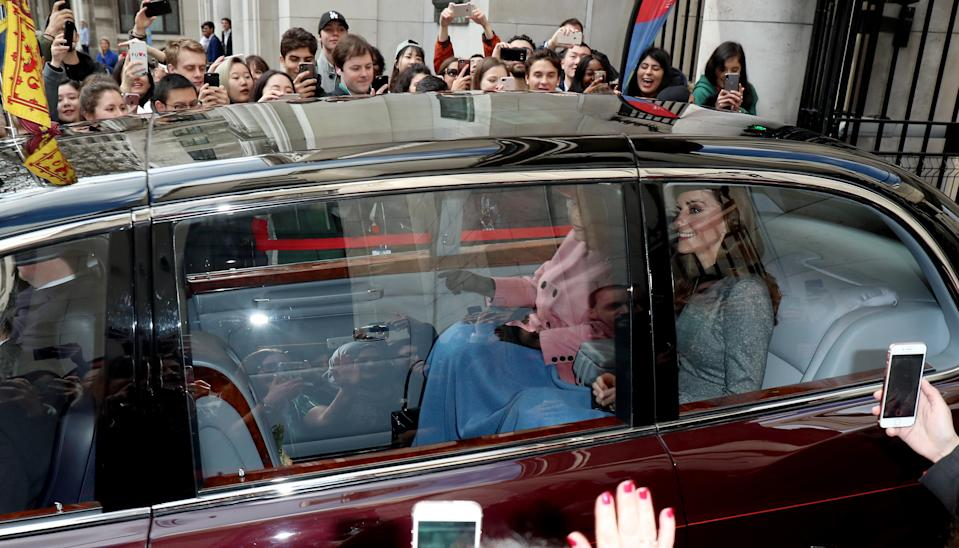 The Queen and the Duchess of Cambridge arrive at King's College London together, even sharing a blanket in the car [Photo: Getty]