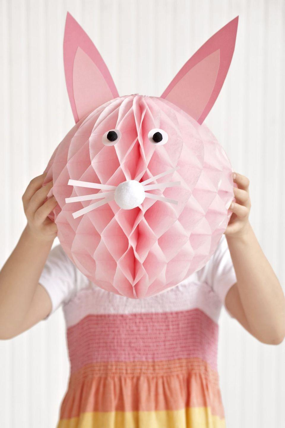 """<p>Need to keep kids occupied? Have them add ears, nose, and eyes to a pink crepe paper ball to make a cute, photo-worthy bunny face.</p><p><strong><a class=""""link rapid-noclick-resp"""" href=""""https://www.amazon.com/Just-Artifacts-Premium-Crepe-Paper/dp/B01F5VJ4TG/?tag=syn-yahoo-20&ascsubtag=%5Bartid%7C10070.g.1751%5Bsrc%7Cyahoo-us"""" rel=""""nofollow noopener"""" target=""""_blank"""" data-ylk=""""slk:SHOP CREPE PAPER"""">SHOP CREPE PAPER</a></strong></p>"""