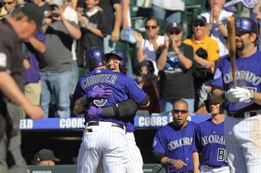 Fowler lifts Rockies past Dodgers 7-6 in 10th