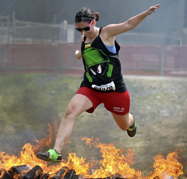 In this June 17, 2012 photo, Kaitlin Karalunas of Pittston comes down the home stretch of the Warrior Dash at Pocono Raceway in Long Pond, Pa. Virtually overnight, obstacle courses have become a favorite diversion of thrill-seekers and weekend warriors. (AP Photo/Scranton Times & Tribune, Melissa Evanko) WILKES BARRE TIMES-LEADER OUT; MANDATORY CREDIT