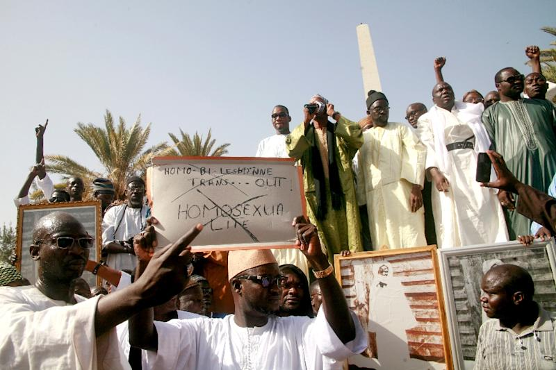 Demonstrators in Senegal hold up a placard reading 'Gays, lesbians, bisexuals, transgenders - out' in a 2016 protest (AFP Photo/MOUSSA SOW)