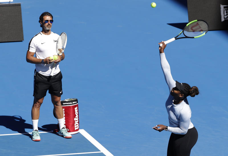 United States' Serena Williams is watches by her coach Patrick Mouratoglou during a practice session at the Australian Open tennis championships in Melbourne, Australia, Sunday, Jan. 13, 2019. (AP Photo/Mark Schiefelbein)