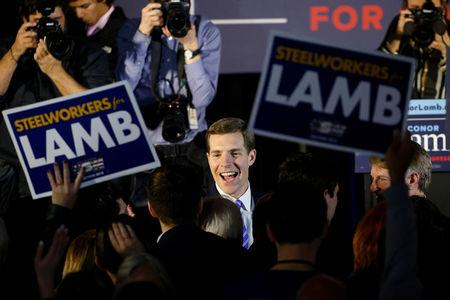 U.S. Democratic congressional candidate Conor Lamb is greeted by supporters during his election night rally in Pennsylvania's 18th U.S. Congressional district special election against Republican candidate and State Rep. Rick Saccone, in Canonsburg, Pennsylvania, March 13, 2018. REUTERS/Brendan McDermid