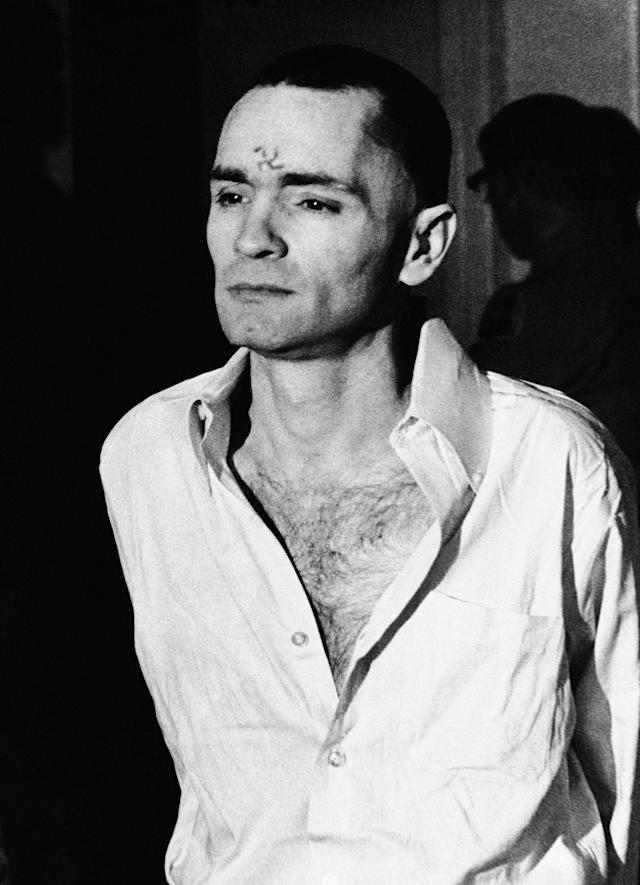 <p>Charles Manson, clean-shaven and with a swastika scratched on his forehead, walks to court, March 12, 1971, in Los Angeles, for a hearing in the penalty phase of the trial. (Photo: AP) </p>