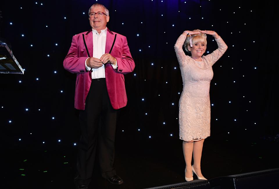 LONDON, ENGLAND - OCTOBER 15:  Barbara Windsor (R) and Christopher Biggins perform during the Amy Winehouse Foundation Gala at The Savoy Hotel on October 15, 2015 in London, England.  (Photo by Dave J Hogan/Getty Images)