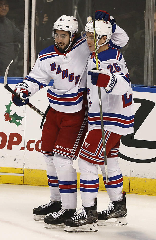 New York Rangers center Mika Zibanejad, left, and New York Rangers left wing Jimmy Vesey, right, celebrate after Zibanejad scored during the first period of an NHL hockey game against the Florida Panthers on Saturday, Dec. 8, 2018, in Sunrise, Fla. (AP Photo/Brynn Anderson)