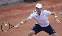 Spain's Roberto Bautista Agut plays a return to Switzerland's Henri Laakosonen during their second round match on day four of the French Open tennis tournament at Roland Garros in Paris, France, Wednesday, June 2, 2021. (AP Photo/Thibault Camus)