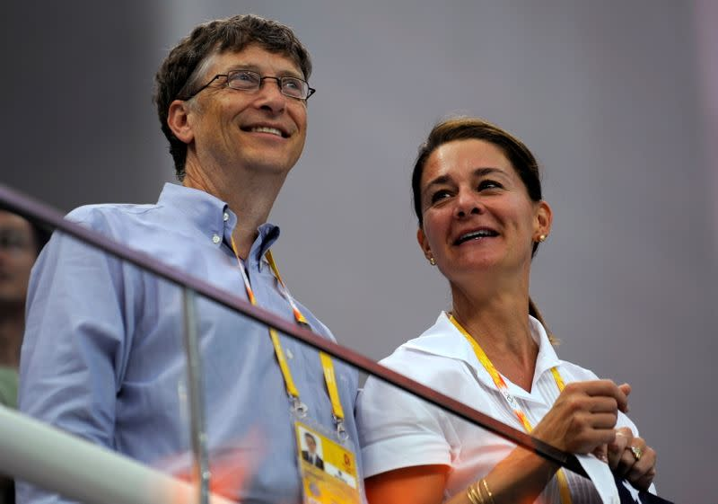 FILE PHOTO: Microsoft Corp co-founder Bill Gates and his wife Melinda Gates watch the swimming events at the National Aquatics Center during the Beijing 2008 Olympic Games