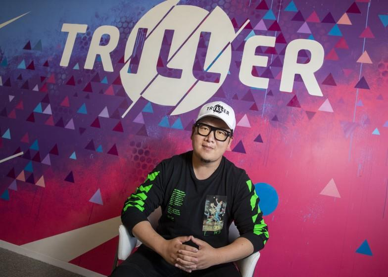 "Triller CEO Mike Lu sits for a portrait on Aug. 6 in Century City. The social video app has surged in popularity as TikTok's business in the U.S. is threatened by an executive order from President Trump. <span class=""copyright"">(Brian van der Brug / Los Angeles Times)</span>"
