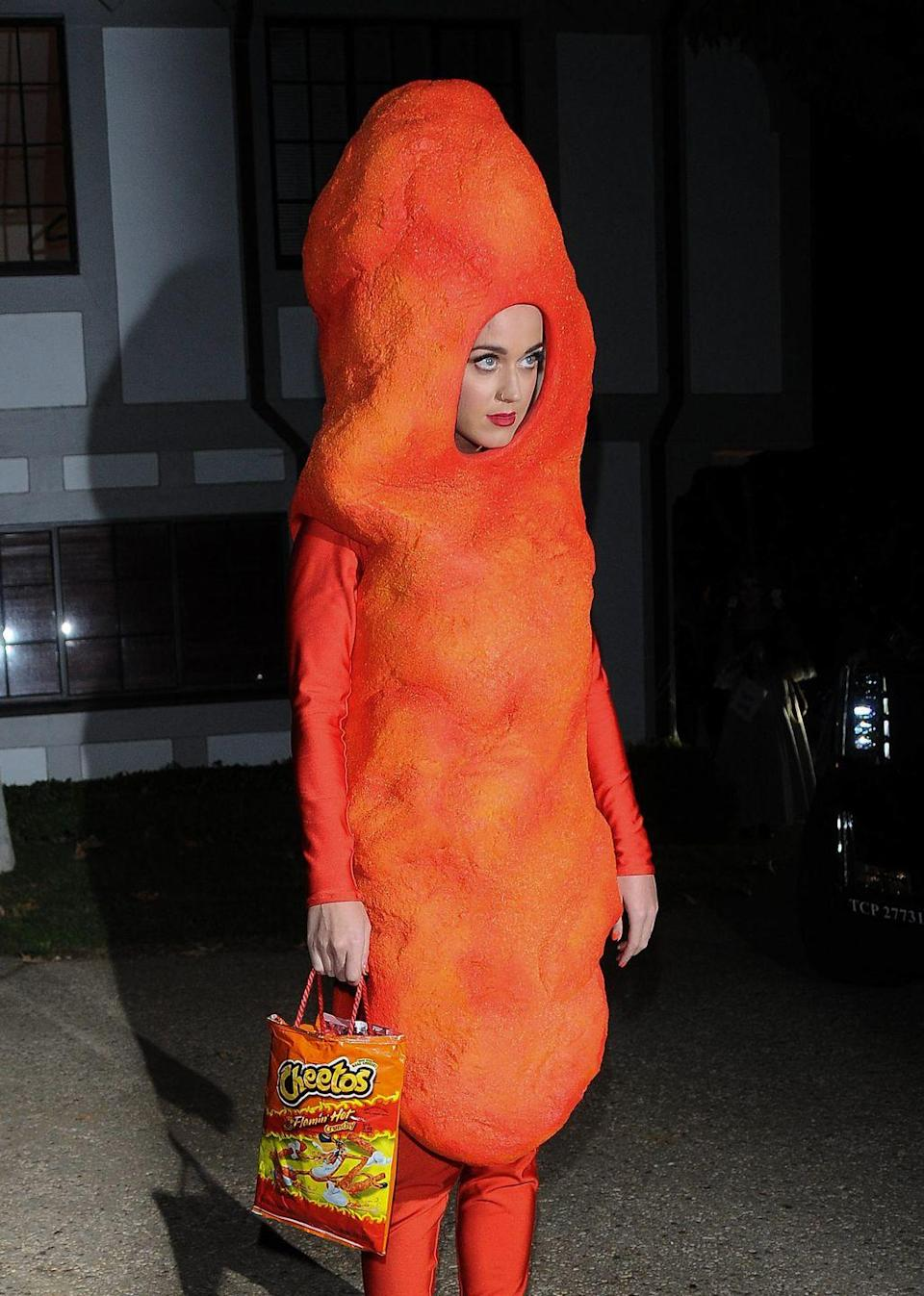 "<p>Now, this costume would make us hungry. Katy lived up to the saying, ""You are what you eat,"" when she arrived at Kate Hudson's Halloween party as a tasty Cheeto. </p>"