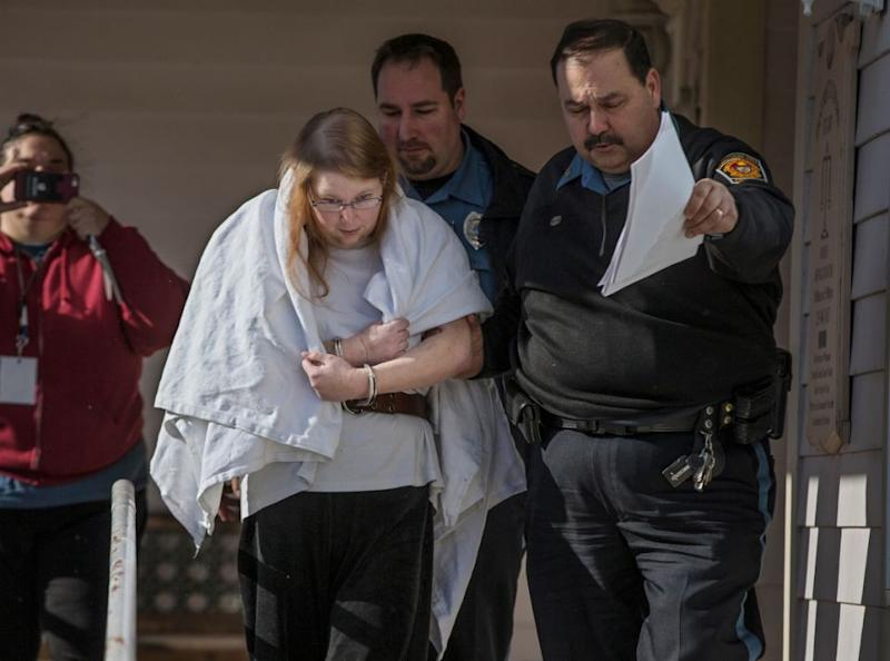 Sara Packer, handcuffed, was led out of District Court on Sunday. Source: AP