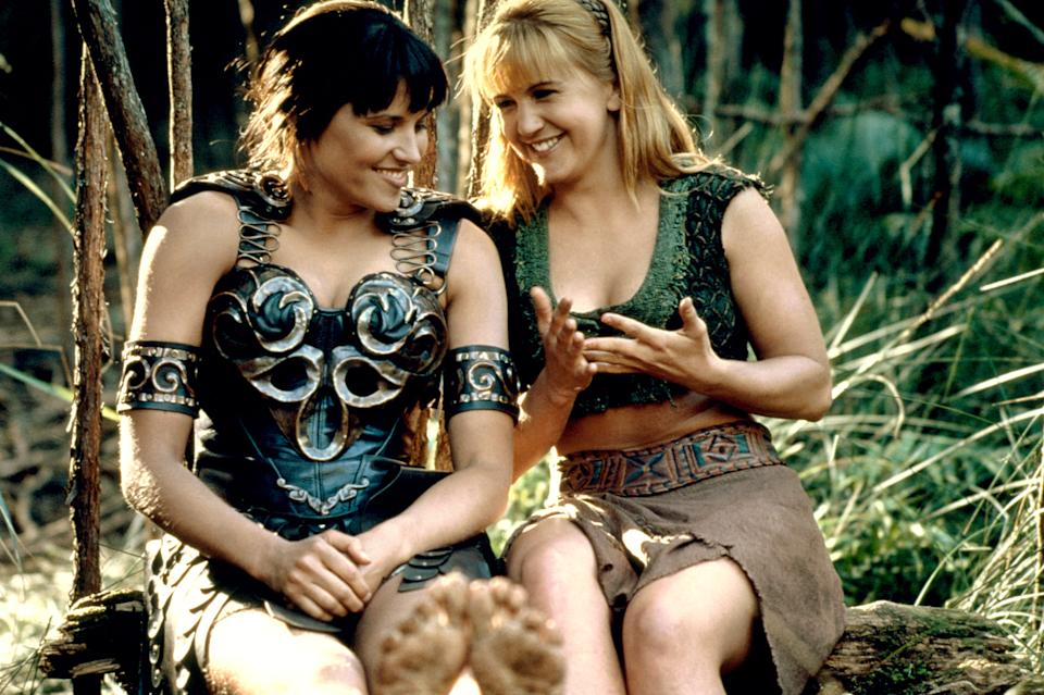 Xena (Lucy Lawless) and Gabrielle (Renee O'Connor) are widely regarded as one of fandom's most endearing--and enduring--same-sex couples. (Photo: Universal Television / Courtesy: Everett Collection)