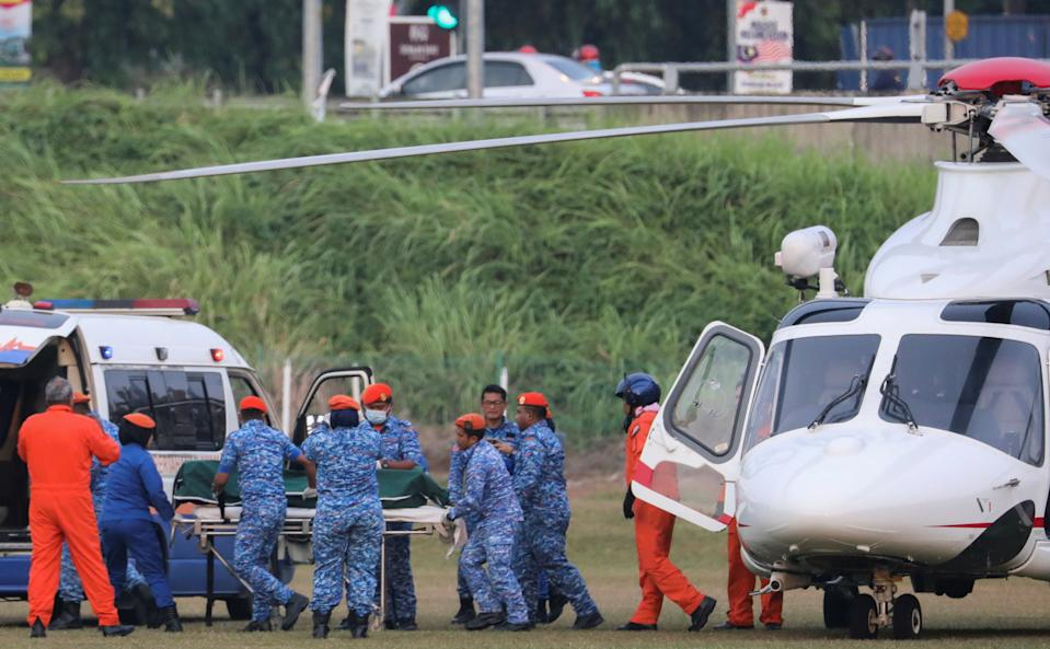 Nora Anne Quoirin's body is brought out of a helicopter in Seremban, Malaysia.