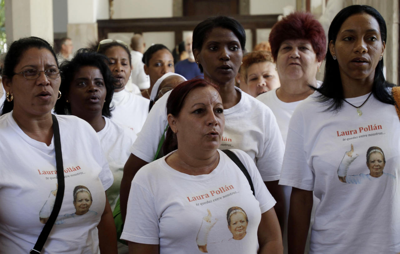 Members of dissident group Ladies in White pray in Santa Rita church before holding their weekly march in Havana, Cuba, Sunday March 18, 2012. Dissident Angel Moya says police detained his wife Bertha Soler and three dozen supporters of the Ladies in White dissident group on Sunday morning. The detentions come just over a week ahead of a visit by Pope Benedict XVI, who is likely to bring up the issue of religious, political and human rights during his tour. The image of the woman on their shirts is of Laura Pollan, the group's former leader who died in 2011 of a heart attack. (AP Photo/Franklin Reyes)