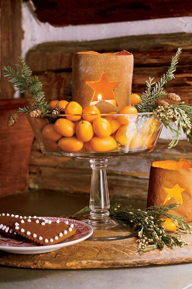 """<p>Fill a glass compote dish with fresh clementines, pine boughs, and candles for a display that smells as good as it looks.</p><p><a class=""""link rapid-noclick-resp"""" href=""""https://go.redirectingat.com?id=74968X1596630&url=https%3A%2F%2Fwww.crateandbarrel.com%2Ffooted-10-oz.-dessert-dish%2Fs465291&sref=http%3A%2F%2Fwww.countryliving.com%2Fdiy-crafts%2Fg644%2Fchristmas-tables-1208%2F"""" rel=""""nofollow noopener"""" target=""""_blank"""" data-ylk=""""slk:SHOP COMPOTE DISHES"""">SHOP COMPOTE DISHES</a></p>"""