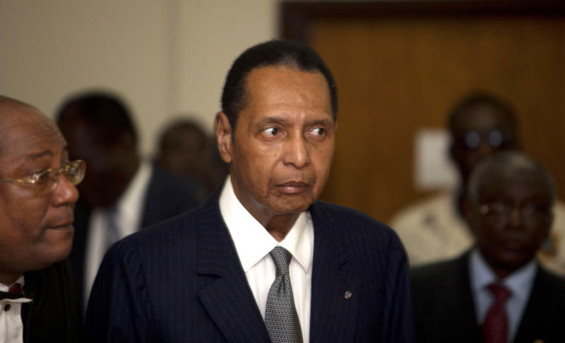 "FILE - In this Feb. 28, 2013 file photo, former Haitian dictator Jean-Claude Duvalier, known as ""Baby Doc,"" attends his hearing at court in Port-au-Prince, Haiti. Alleged victims of the government of  Duvalier have resumed their testimony in court Thursday, March 14, 2013. Haitian authorities charged Duvalier with human rights abuses and embezzlement but a judge ruled he should face charges only for the alleged financial crimes. An appellate court is trying to decide if it should reinstate the abuse charges against Duvalier or drop the alleged financial crimes. (AP Photo/Dieu Nalio Chery, File)"