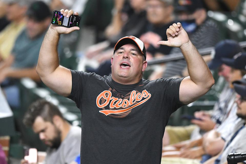 Orioles fan gives thumbs down at Camden Yards.
