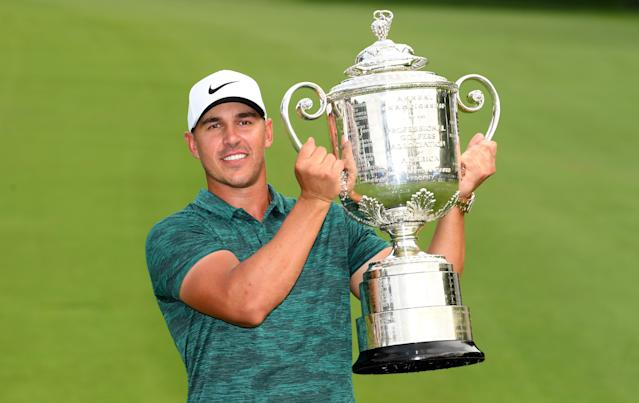 """<div class=""""caption""""> Brooks Koepka celebrates with the winners trophy on the 18th green after winning the 2018 PGA Championship at Bellerive Golf & Country Club on August 12, 2018 in St Louis, Missouri. </div> <cite class=""""credit"""">Ross Kinnaird</cite>"""