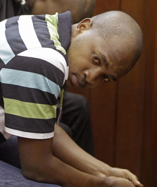 FILE In this file photo taken Friday, Feb 10, 2012, South African Mziwamadoda Qwabe sits in the dock at court in Cape Town, South Africa. One of two South African men accused of being hired by a British newlywed to kill his Swedish bride pleaded guilty Wednesday Aug. 8, 2012 to his involvement in the slaying, a prosecution spokesman said. Mziwamadoda Qwabe pleaded guilty to kidnapping, robbery, murder and illegal possession of a firearm over the November 2010 killing of Anni Dewani, whose body was found in an abandoned taxi in Cape Town's impoverished Gugulethu township, said Eric Ntabazalila, a spokesman for South Africa's National Prosecuting Authority. (AP Photo/Schalk van Zuydam-File)
