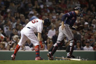 Minnesota Twins catcher Jason Castro runs to the dugout after Boston Red Sox's Andrew Benintendi struck out to end the fourth inning of a baseball game at Fenway Park, Tuesday, Sept. 3, 2019, in Boston. (AP Photo/Elise Amendola)
