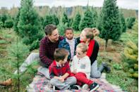 """<p>Try to get everyone down on the same level. """"If you have small children, pick them up or sit together on a blanket for some of the photos,"""" says Wojtowicz. """"This lets the photographer capture a close family portrait as well as cozy intimate family moments.""""</p><p>""""We keep chairs and stools handy, and I always carry apple boxes in my car,"""" says Ana Brandt Photography of <a href=""""http://www.anabrandt.com/"""" rel=""""nofollow noopener"""" target=""""_blank"""" data-ylk=""""slk:Ana Brandt Photography"""" class=""""link rapid-noclick-resp"""">Ana Brandt Photography</a>. """"You can sit and stagger people so the height difference is not so obvious.""""</p><p><strong>RELATED:</strong> <a href=""""https://www.goodhousekeeping.com/holidays/christmas-ideas/advice/g2938/funny-christmas-card-ideas/"""" rel=""""nofollow noopener"""" target=""""_blank"""" data-ylk=""""slk:26 Funny Christmas Cards That Will Crack Up Your Friends and Family"""" class=""""link rapid-noclick-resp"""">26 Funny Christmas Cards That Will Crack Up Your Friends and Family</a></p>"""