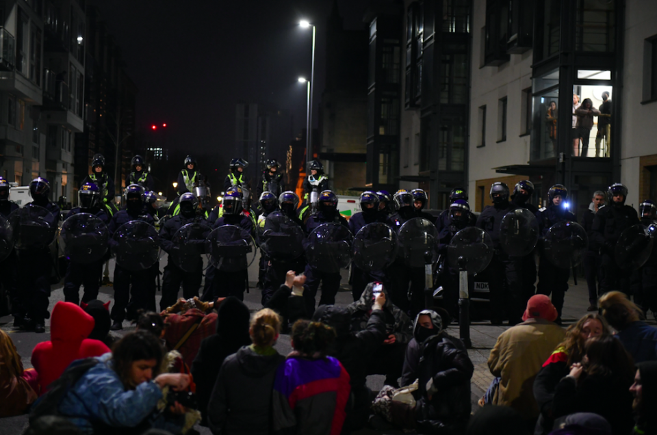 Police and protesters in Bristol face each other during a second night of demonstrations. (SWNS)