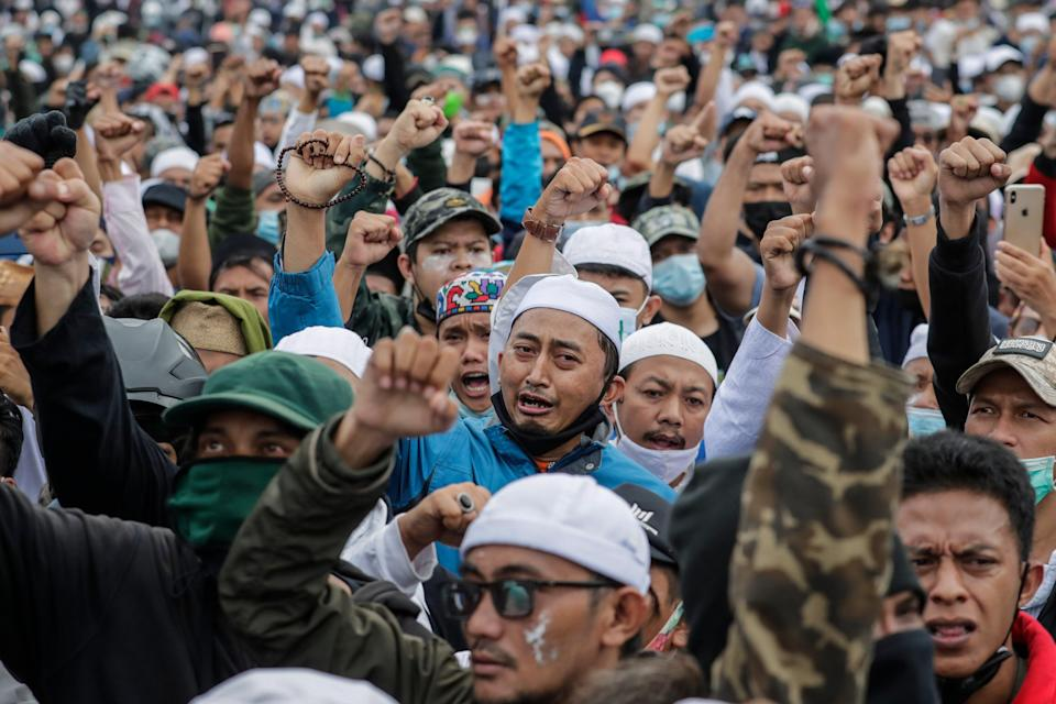 Supporters of Indonesian cleric Rizieq Shihab shout slogans during a protest near the East Jakarta district court on 24 June, 2021 (EPA)