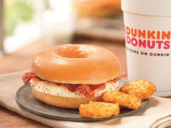 Dunkin Donuts breakfast sandwich, hash browns, and coffee