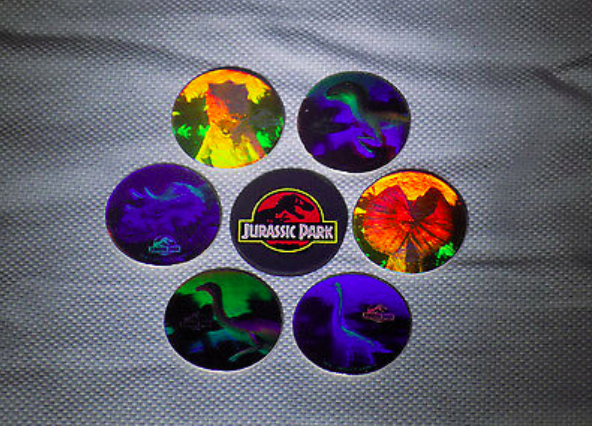 """<p>Okay, let's be real. Most Pogs are worthless. These Pogs, however, were for sale on eBay for <a href=""""https://www.ebay.com/itm/SOLD-OUT-Jurassic-Park-6-Hologram-Pog-set-with-Slammer/161967505671?hash=item25b6040107:g:Mg0AAOSwA4dWNNlq"""" rel=""""nofollow noopener"""" target=""""_blank"""" data-ylk=""""slk:a million dollars"""" class=""""link rapid-noclick-resp"""">a million dollars</a>. IDK if the internet is pranking us or what, but there you have it.</p>"""