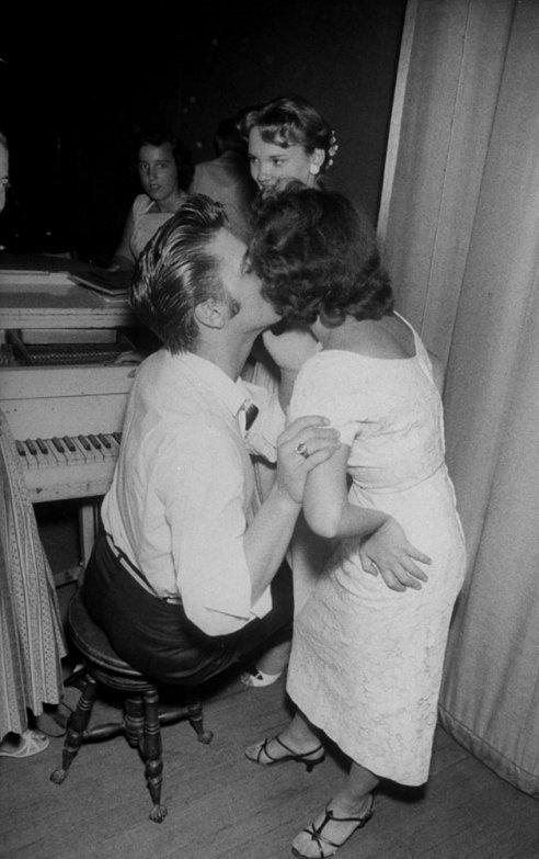 "Elvis kisses Andrea June Stephens, who came to Jacksonville from Atlanta, Ga., after writing prizewinning letter on why she would like to meet Elvis. Promised a dinner date with Elvis, she got instead a cheeseburger in a Jacksonville diner.""   Click here to see the full collection at LIFE.com."