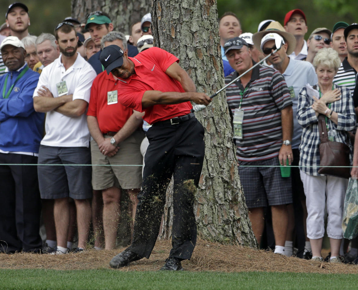 Tiger Woods hits his second shot off the first fairway during the fourth round of the Masters golf tournament Sunday, April 14, 2013, in Augusta, Ga. (AP Photo/Darron Cummings)