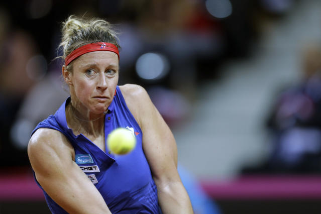 Pauline Parmentier of France returns the ball to Sloane Stephens of USA during the Fed Cup semifinal singles tennis match in Aix-en-Provence, southern France, Saturday, April 21, 2018. (AP Photo/Claude Paris)