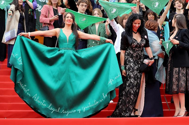 "A wave of green hit the red carpet in Cannes as pro-choice activists arrived for the screening of ""Let It Be Law"", a documentary which tells the story of the struggle for women's rights in Argentina (AFP Photo/Valery HACHE)"