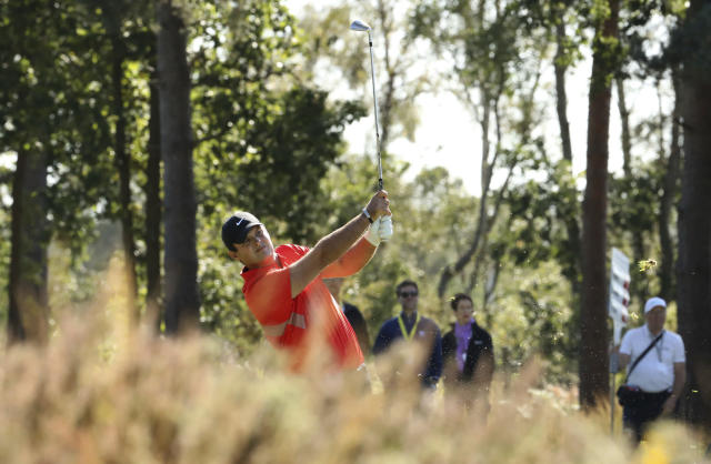 Patrick Reed of the US plays a shot on the 9th hole during the PGA Championship at Wentworth Golf Club, Wentworth, England, Friday Sept. 20, 2019. (Bradley Collyer/PA via AP)